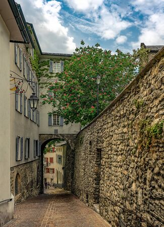 Narrow street with flowering chestnuts in Switzerland, Sion. Architecture and landmark of Switzerland. Cozy cityscape of Switzerland. 版權商用圖片