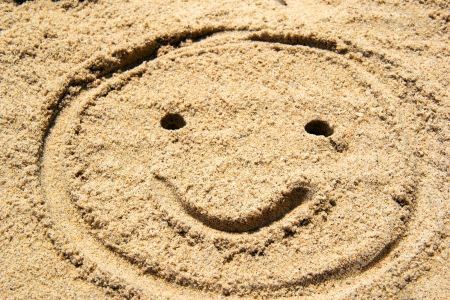 fun sand drawing smile face photo
