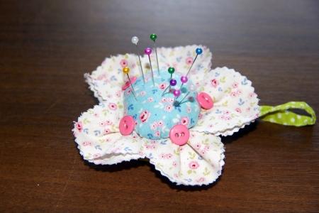 pinhead: handmade pin cushion as flower on the table