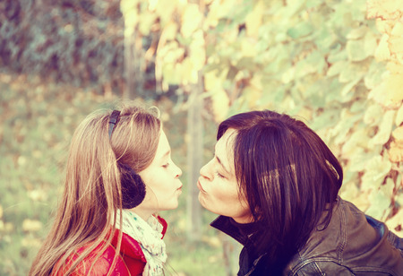 mother and daughter in the vineyard  in autumn photo