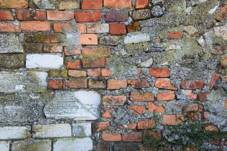 falling apart: old stone fence falling apart  big background