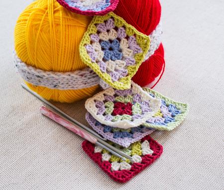 Balls for crochet hooks and knitting fragments. Handicraft.
