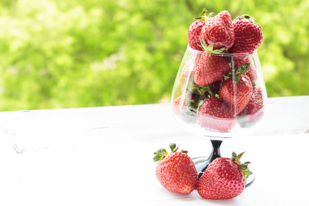 Fresh strawberries in a glass goblet. Dessert made from fresh strawberries. Selective focus.