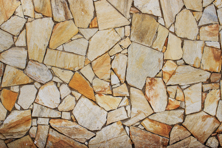 Stone wall. Fragments of masonry. Natural background.