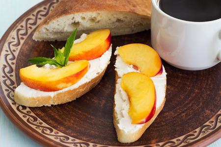Coffee and sandwiches with cream cheese. Breakfast. 版權商用圖片