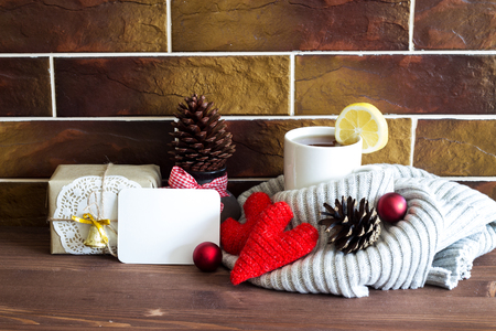 Christmas and New Year background. Christmas composition with a cup of tea and a gift. The concept of home, cozy and warm winter holidays. 版權商用圖片