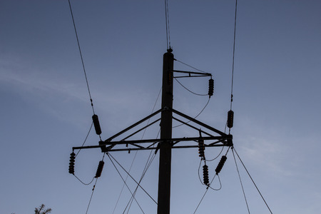 Power line against the evening sky. Copy space. Elements of the high-voltage line. Close-up.