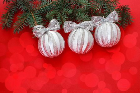 Christmas and New Year background. Christmas balls on a branch of the Xmas tree.