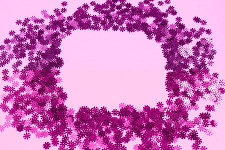 Pink confetti scattered on a pink background. Place for text. Copy space. 스톡 콘텐츠