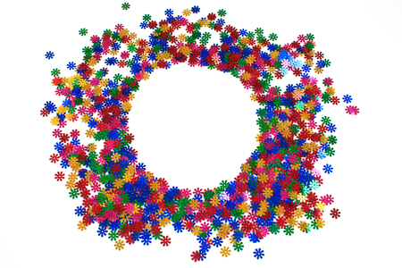 Colorful confetti scattered on white background. Place for text. Copy space. 스톡 콘텐츠