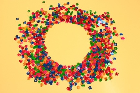Colorful confetti scattered on a light background. Place for text. Copy space.