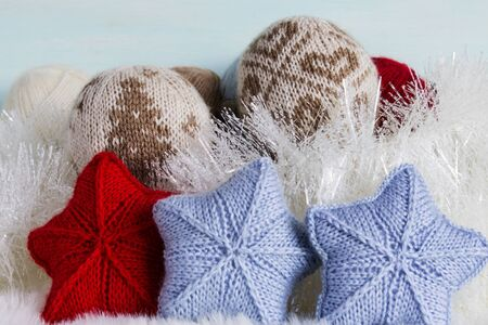Warm and cozy knitted Christmas background. The concept of warm and cozy winter holidays.