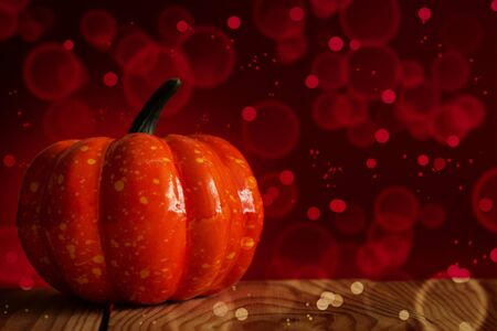 Halloween. Pumpkin. Traditional halloween decor and festive lights. Place for text.