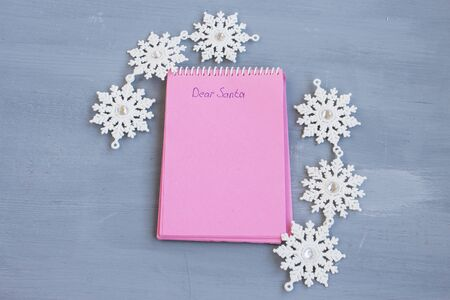 The inscription Dear Santa in a notebook. Christmas wish planning concept. A wish list. Flat layout. Copy space.