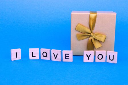 Gift box and text i love you. The concept of romantic relationship. Lovely postcard for Valentines Day.
