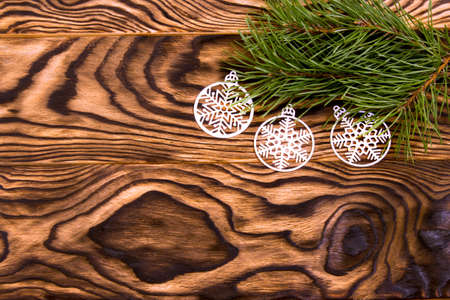 Christmas and New Year composition. Branches of a Christmas tree and original Christmas balls. Christmas ornaments. Christmas and New Year decorations with place for text. Flat layout. View from above. Copy space.