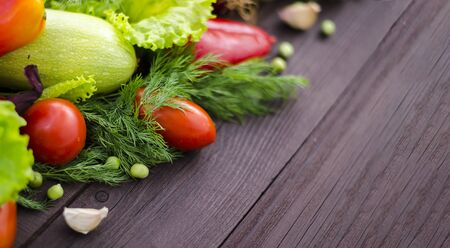 Assorted fresh vegetables. Detox, vegan and clean diet. Fresh vegetables are on the wooden table, green peas in the foreground. Panorama, banner, copy space.