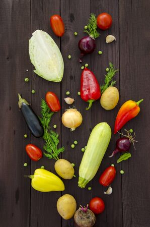 Assorted fresh vegetables. Detox, vegan and clean diet. Fresh vegetables on a wooden table. The explosion of vegetables. Panorama, banner, copy space.