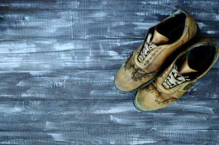 On this page you can see old sneakers. Sneakers with bootlace. Sneakers are brown. Sneakers are very old and shabby. The sole is removed. Close-up. Copy space. Stok Fotoğraf