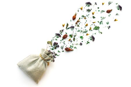 Herbal tea, dry plants and flowers, oregano and mint vitamin drink in a linen bag, isolate, place for text, copy space