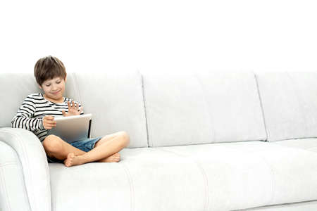 Kids and gadgets. Distance learning. Boy and laptop at home. Lifestyle. Lockdown and Social Distancing.