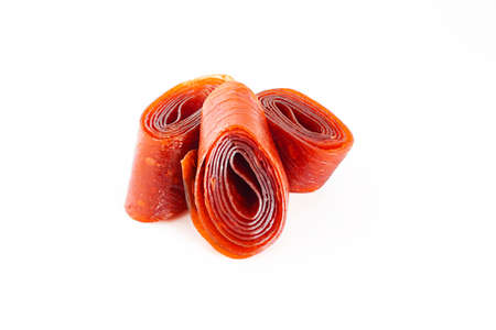 fruit pastille from apples and apricots, dried leaves of mashed fruit and berries. Organic food. Natural products. Isolated.