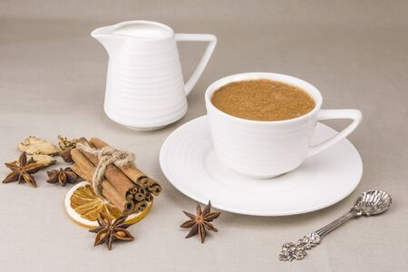 Masala tea is a traditional Indian drink in a Cup with spices Stock Photo