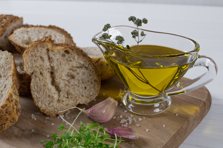 Healthy snack. Cereals bread, olive oil with herb spicy and garlic. Fresh cress salad. Ingredients. On wooden Background.
