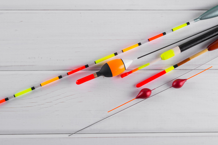 Set of fishing floats  on a wooden white background.