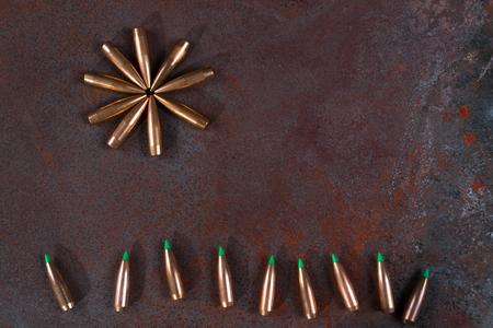 postwar: War and Peace, Sun(flower) and grass from bullets. Hope concept Stock Photo