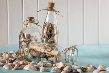 Souvenirs like a bottles with seashells. Interior decoration. Memories about vacation
