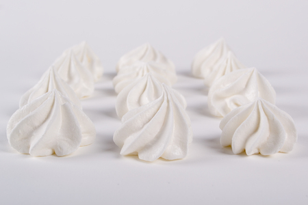 Meringue cookies blur. Soft selective focus.  Background  with blurry mini meringues cookies. Closeup Stock Photo