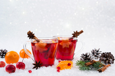 Christmas mulled wine and ingredients. On white snow background with copyspace