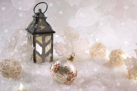 New Year's decoration ball on snow background. Christmas card