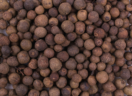 Dry  whole allspice, jamaica peppe. Texture background