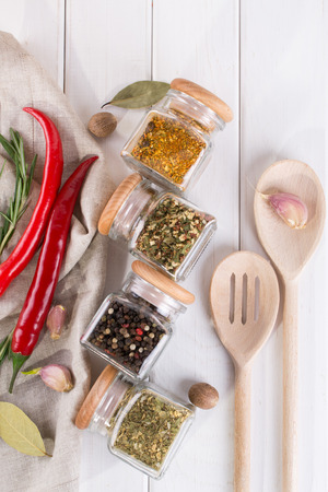 Colorful spices and herbs for cooking background and design top view. Flat lay