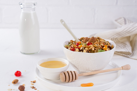 Bowl with homemade granola on white background for healthy breakfast . Healthy snak.  Stockfoto