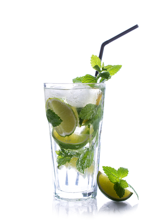Refreshing glass of tradition Summer drink mojito with lime and mint isolated on white