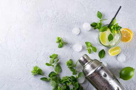 Ingredients for Mojito Cocktails or other drinks on a gray concrete background