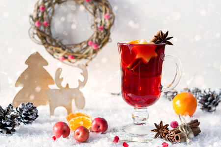 Wooden  vintage rustic christmas decoration and hot mulled spiced red wine in glass mug Interior eco decor. Christmas or new year card Stock Photo