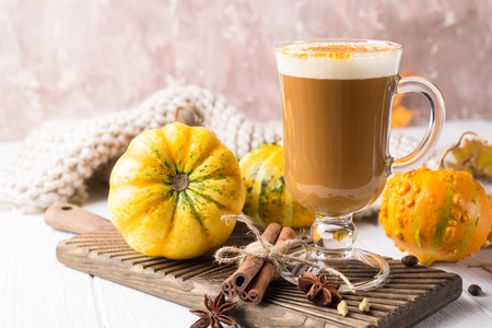 Pumpkins spice latte with pumpkins Copy space. Pumpkin latte - cozy drink for cold fall or winter Stock Photo