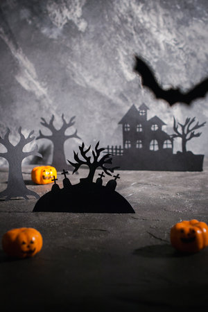 Night  landscape,scary houses silhouettes in a dark misty forest