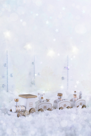 New Year card with toy train in a fairy forest  on winter Stock Photo