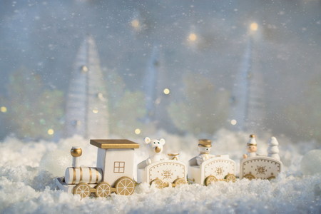New Year card with toy train in a fairy village on winter