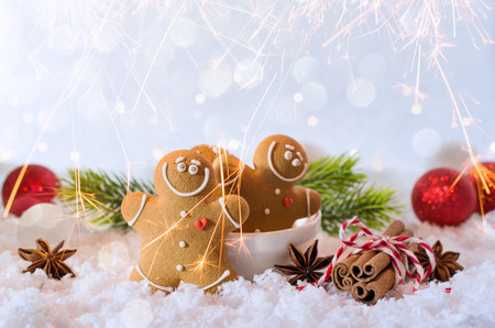 Happy chill out time,Group of smiling  gingerbread men cookies celebrate Christmas and New Year Party with bengal lights. Magic and fairy tale Template, greeting card Stock Photo