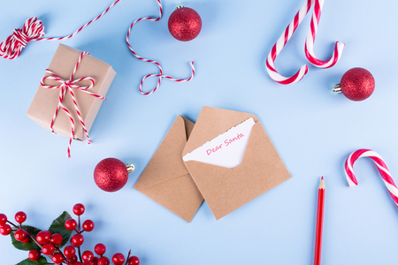 Letter to Dear Santa. Craft envelopes on christmas holiday background. Flat lay.