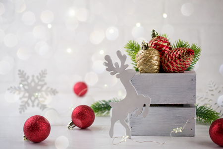 Christmas home decoration with  green fir branches, deer and lights on white background. Mock-up Stock Photo