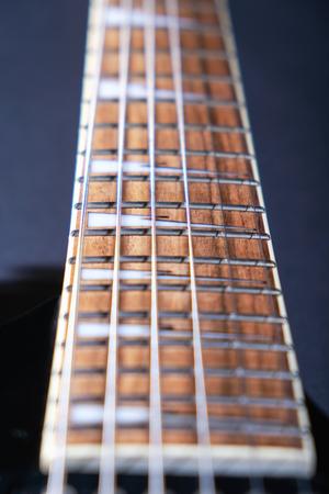 Electric guitar macro shot of a fretboard.Soft selective focus. On black background 免版税图像
