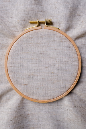 White blank canvas on wooden round frame as a background. Flat lay top view of a mockup