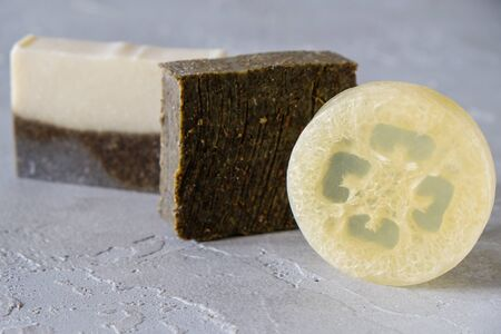 Bars of natural soap with dried herbs and soap with loofah. Natural Herbal Products. Spa cosmetics
